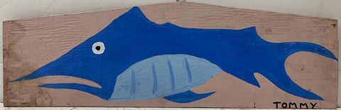A Tommy Cheng painting of a blue, frowning fish.