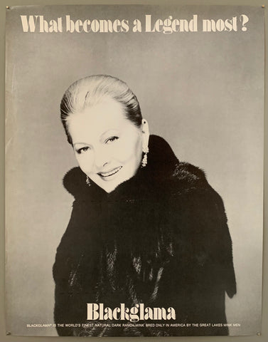 A smiling blonde woman with her hair up in a fur coat. The text is on the top and the bottom in black.