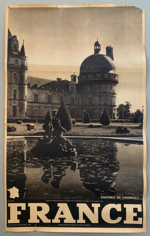 This poster is sepia toned with bold black-and-white writing at the bottom, as well as a tiny map of France. The photograph takes up the majority of the page.The photograph mostly contains a part of the castle that reflects onto a lilypad covered pond. The gardens with shrubbery are between the pond and the domed chateau, and in the middle of the pond is a cherub fountain.
