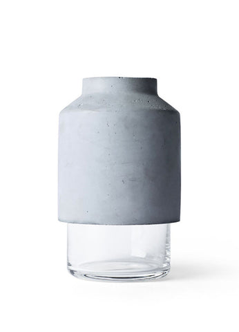 concrete and glass vase