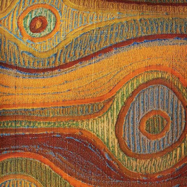 Close up of Aboriginal design on cushion cover. Koyiyoong Campsite is a orange cushion cover