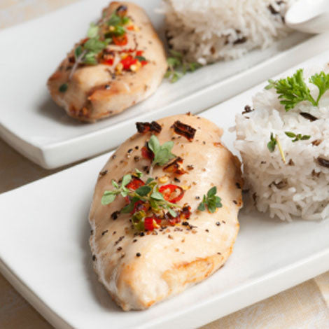 Cooked chicken breast with chillies image