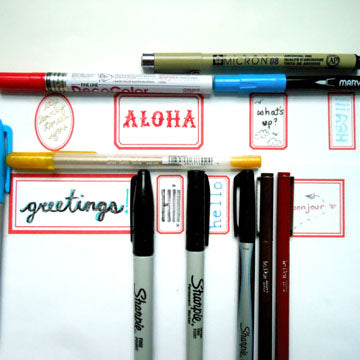Group shot of labels with different writing utensils.