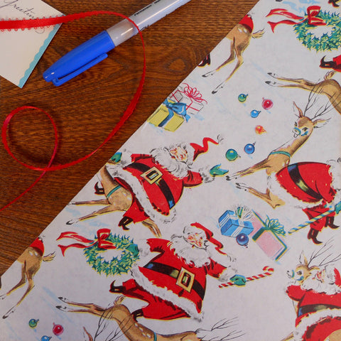 vintage illustrated santa & reindeer gift wrap roll