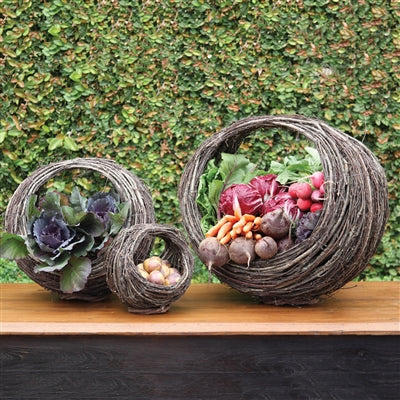 Set of three willow baskets with vegetables and flowers
