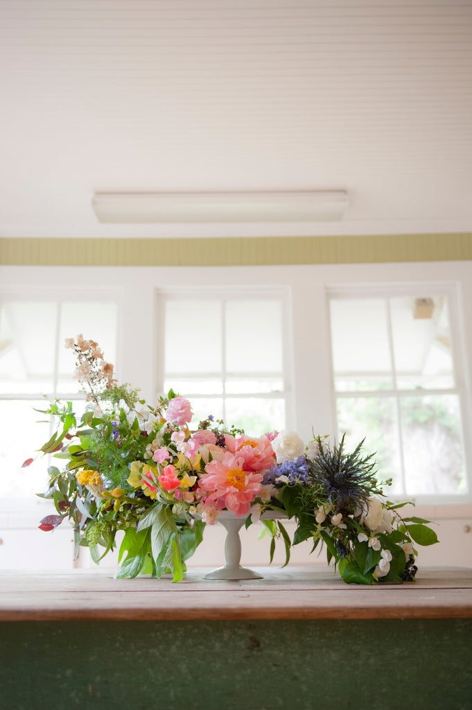 Colorful Spring Summer Flower Arrangement on a White Cake Stand by Christy Hulsey, Colonial House of Flowers With a DIY on Pottery Barn Blog
