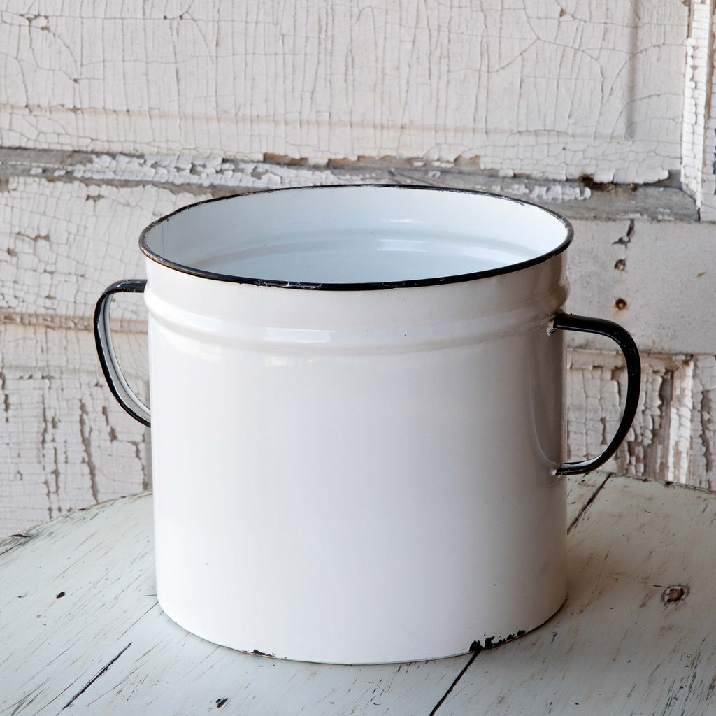 This vintage-style enamel can planter features a lightly distressed, white paint finish.   Lightly distressed white paint finish