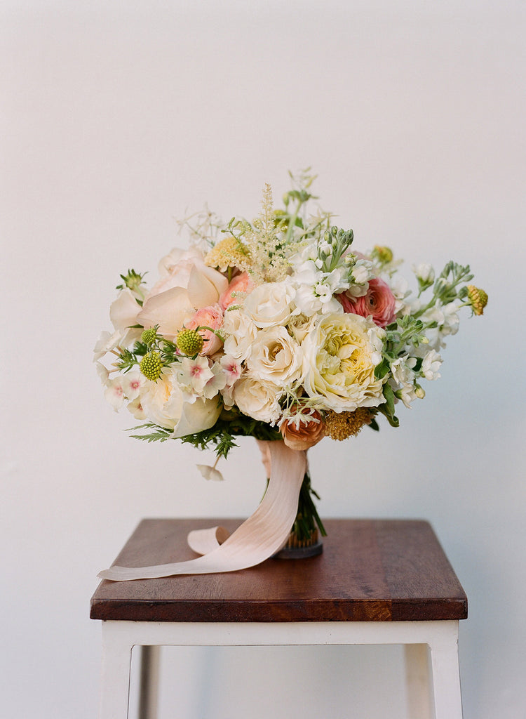Floral Arrangement With Roses And Phlox On Table