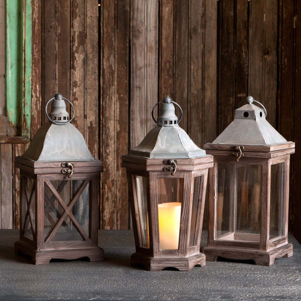 Characterized by simple, clean lines and weathered wood and metal finishes, this petite carriage lantern adds cottage country charm to smaller spaces. May be used indoors or outdoors under a covered area.  Weathered wood and metal finish Finish may vary Find this item and more in our Urban Farmhouse Collection Imported