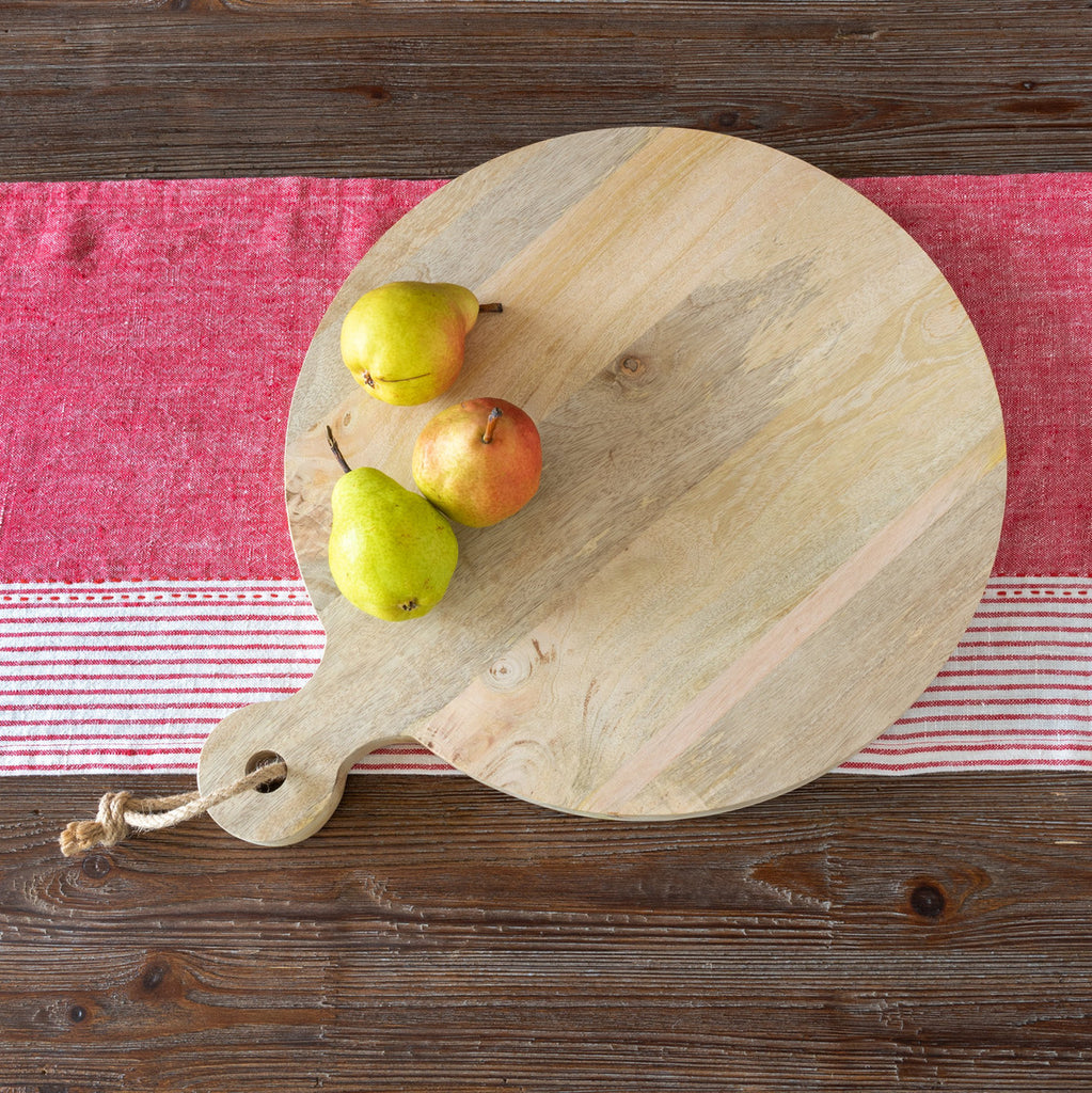 Round-Wood-Cutting-Board-On-Red-Linen-Napkin-With-Pears-Colonial-House-of-Flowers