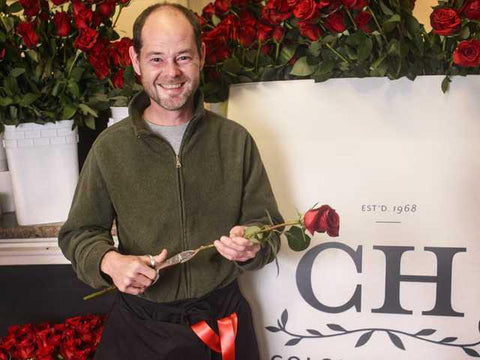 Man-Florist-Colonial_House-of-flowers-with-red-rose