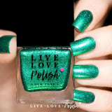 emerald green metallic nail polish with holographic glitter