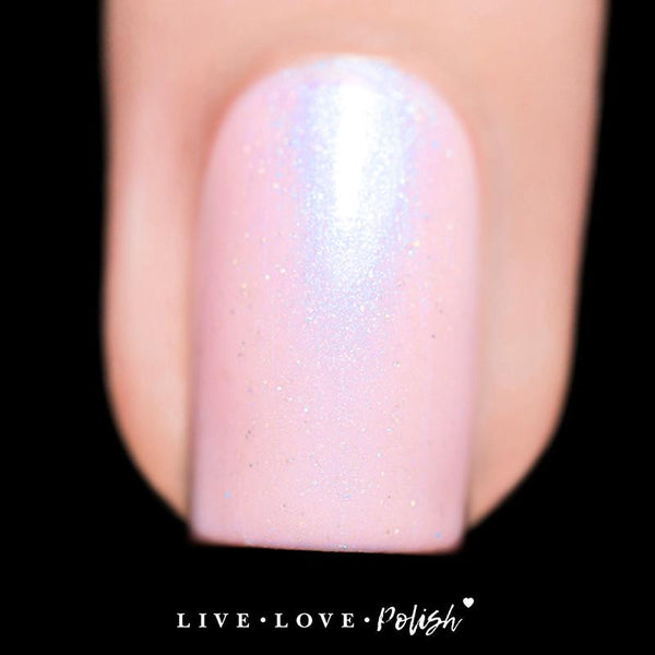 light pink nail polish with blue shimmer