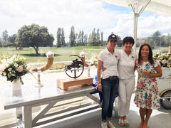 Artist Nicola Lewis with Samantha McIntosh and Kate Plaw beside Takapoto Estate Show Jumping Bronze horse Trophy