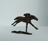 Mini solid bronze horse and jockey by artist Nicola Lewis