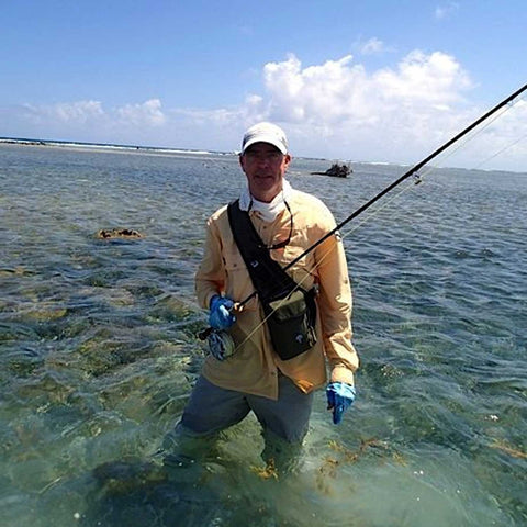 Flats fly fisherman wearing the Tightlines Sling on his front