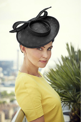 http://tegenaccessories.com/collections/niche-collection/products/black-madeleine-bow-disc-fascinator