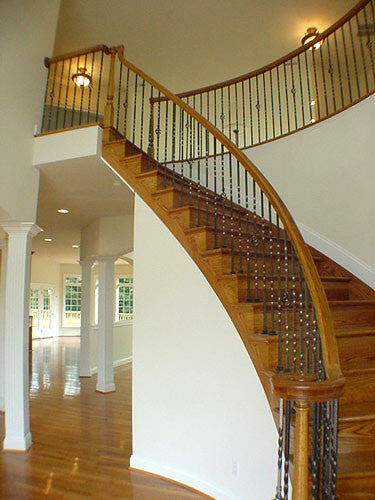 A Beautiful Bending Stairway Deserves a Beautiful Bending Handrail