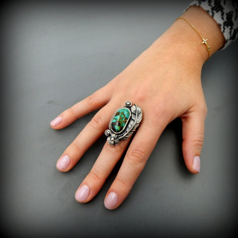 Lovely handcrafted sterling silver Kingman turquoise feather and flower ring