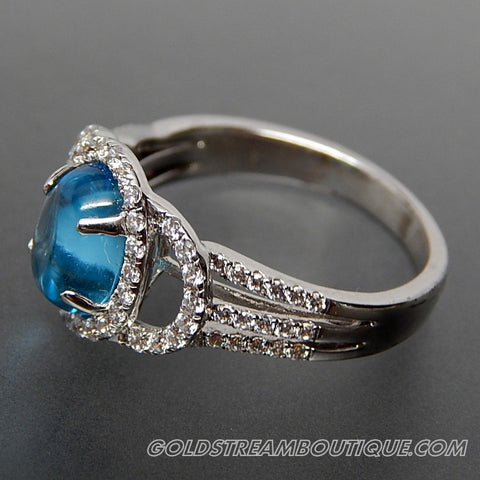 OVAL BLUE TOPAZ CABOCHON & ROUND WHITE CRYSTALS STERLING SILVER COCKTAIL RING - SIZE 7.5