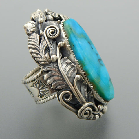 Outstanding handcrafted sterling silver oval American turquoise floral ring (10)