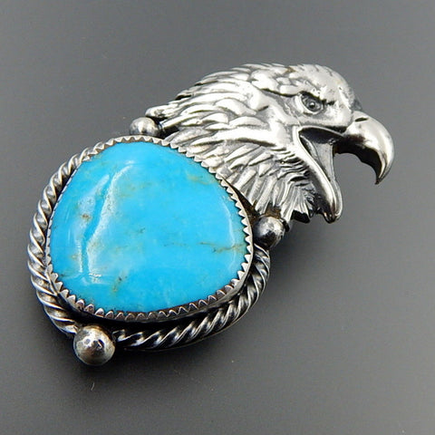 Handcrafted sterling silver bright blue american turquoise eagle pendant