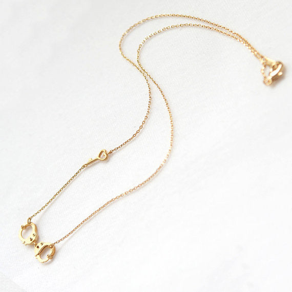 Handcuff and heart key gold necklace