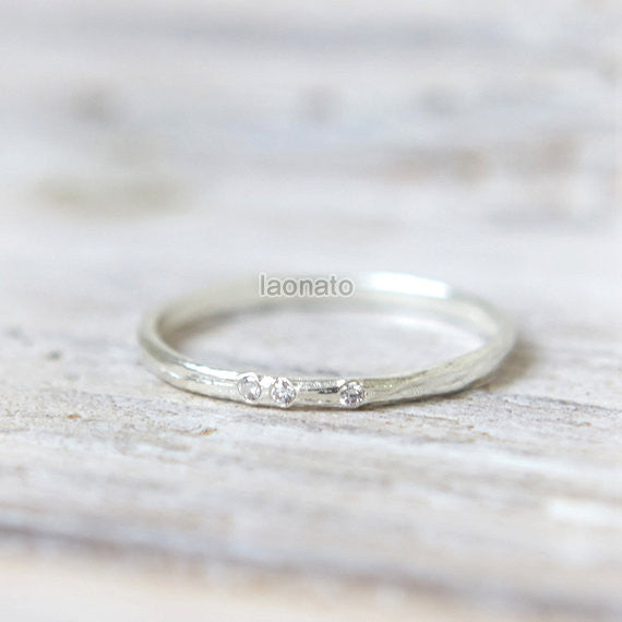 Textured sterling silver ring with 3 CZ