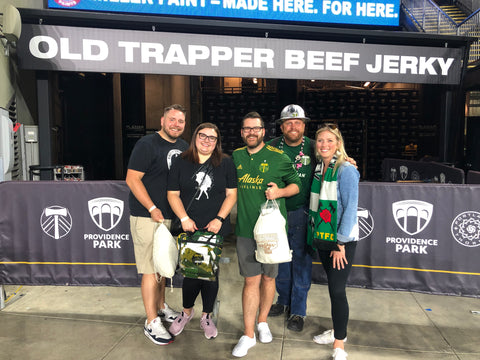 Old Trapper sweepstakes winner posing with Timber Joey, mascot for the Portland Timbers of the MLS