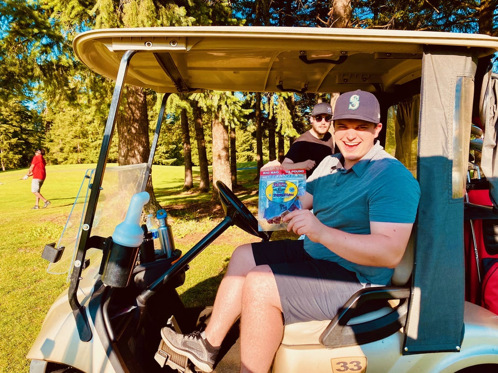Teriyaki Beef Jerky being eaten while on the golf course.