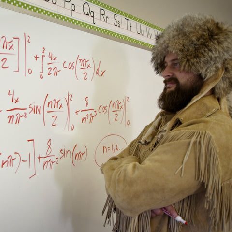 Old Trapper at Chalkboard with Math Problem