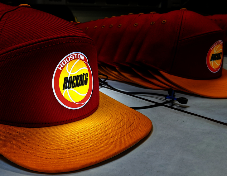 THE OFFICIAL ILLUMINATED HEADWEAR OF THE HOUSTON ROCKETS