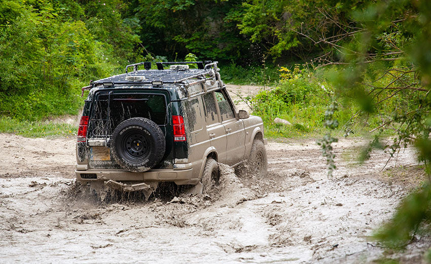 Land Rover Discovery getting muddy off road