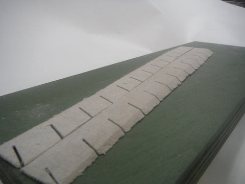 "HO scale 1.5% transition ramp.  Scale 12"" high to zero elevation."