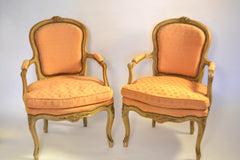 Pair Of Louis XV Carved And Creme Peinte Fauteuils