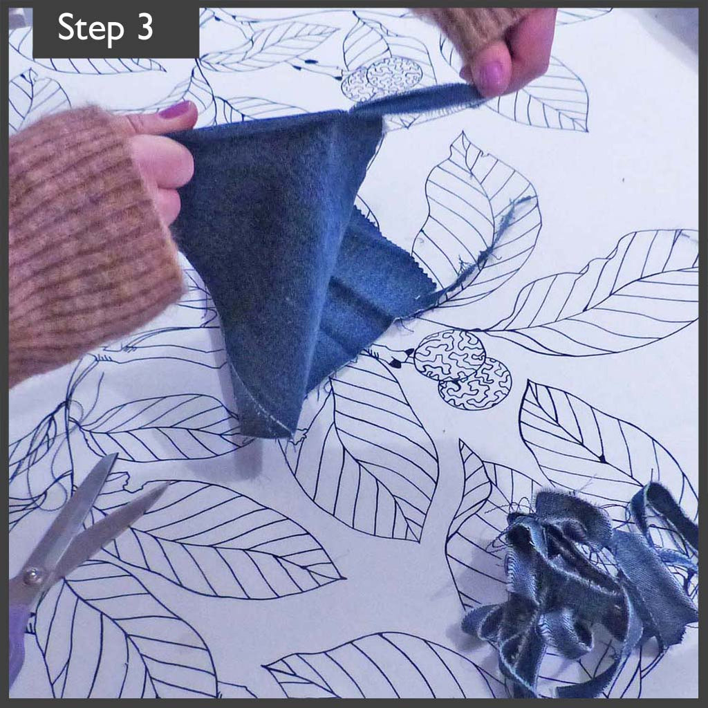 London Craft Club's quick and easy no-sew draft excluder upcycled from jeans is a great craft DIY when it's cold