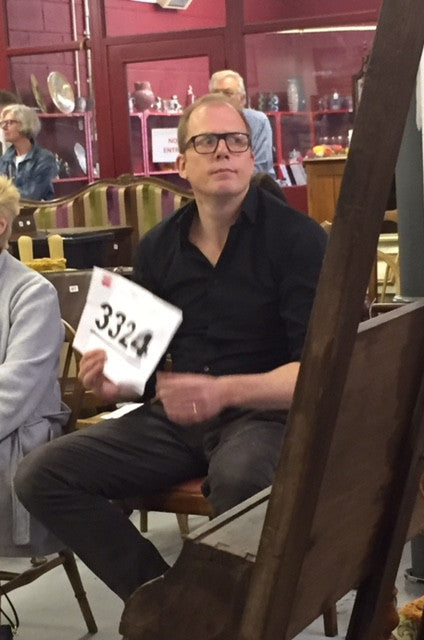 Mr Bownes looking casual while bidding