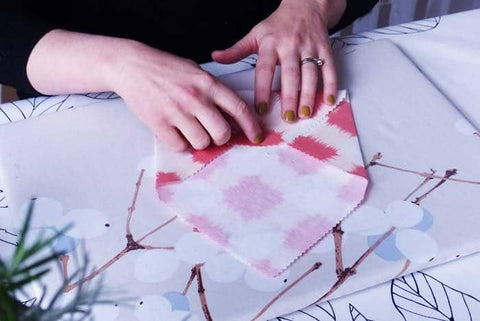 Making fabric envelopes, sealed with a press stud or popper