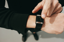 Person pointing toward pavlok band he wears on wrist