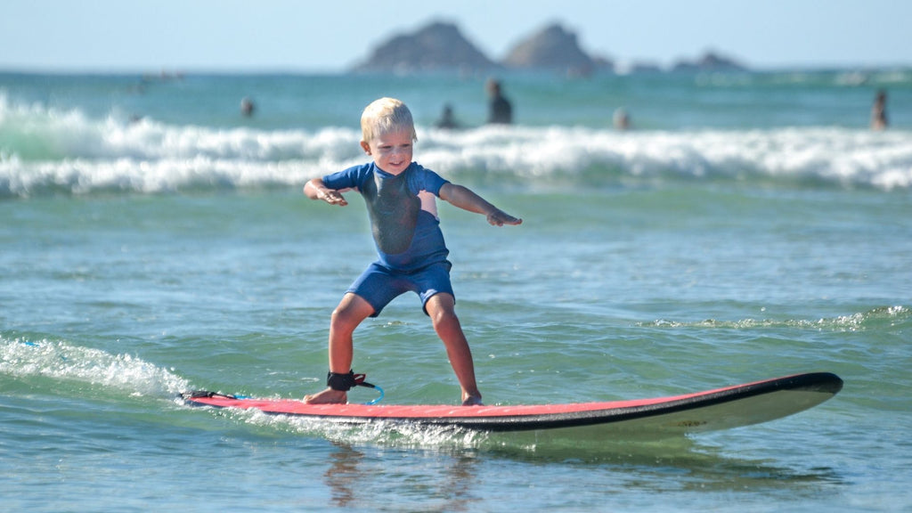 Child Surfing on shallow waters