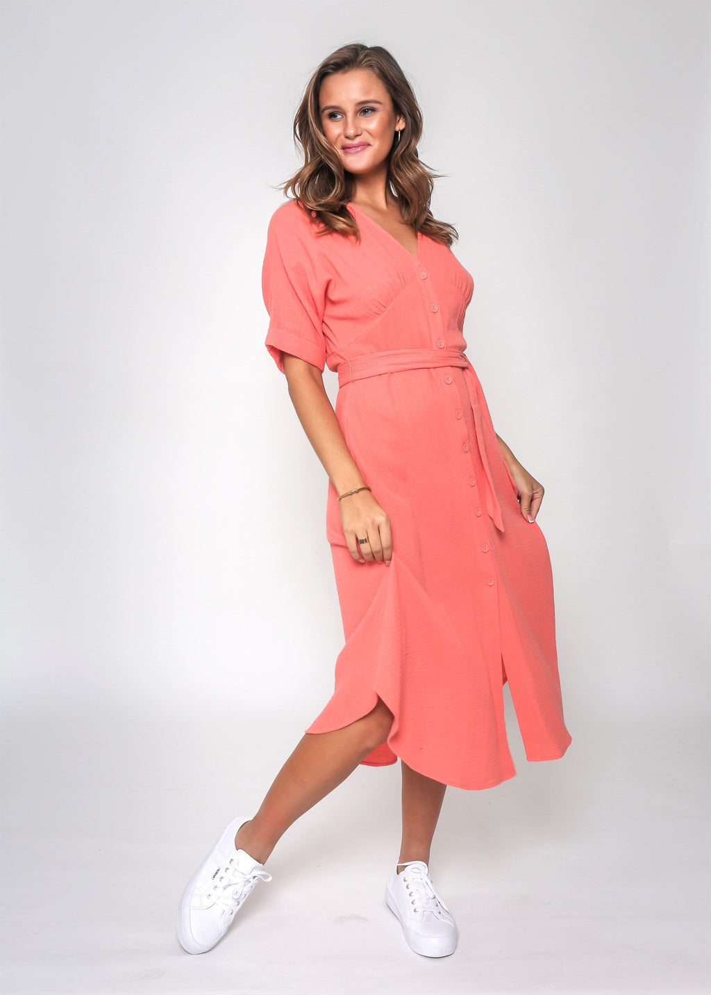 Brunette woman wearing coral midi cotton dress from French Kiss Boutique NZ