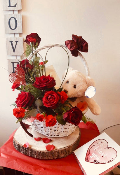 Chocolate, teddy and flowers.