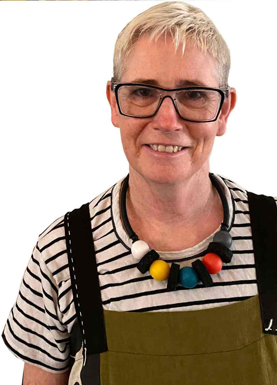 rowan shaw the designer for Frank Ideas wearing the short chunky, multi colored resin necklace