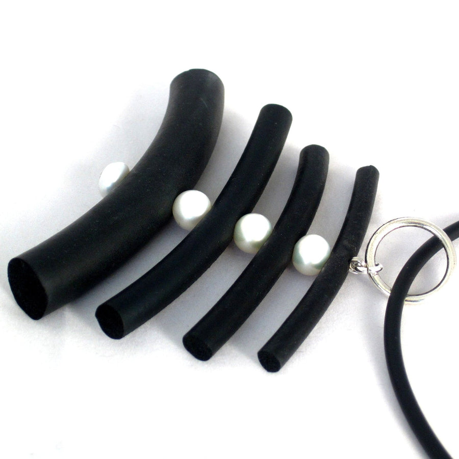 rubber and pearl pendant