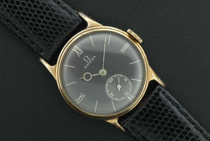 Omega 1926 14Kt. gold case with Roman Numeral markers, gray dial