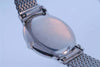 Omega 14Kt. white gold watch, steel bracelet