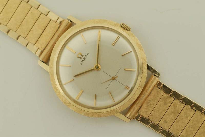 Omega Brush gold bezel
