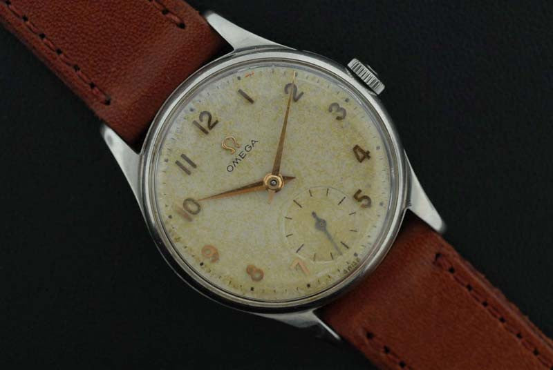 Omega 1950 stainless steel watch with raised gold Arabic marker - SOLD