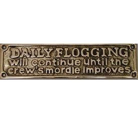 "Brass Sign ""Daily flogging...improves"""