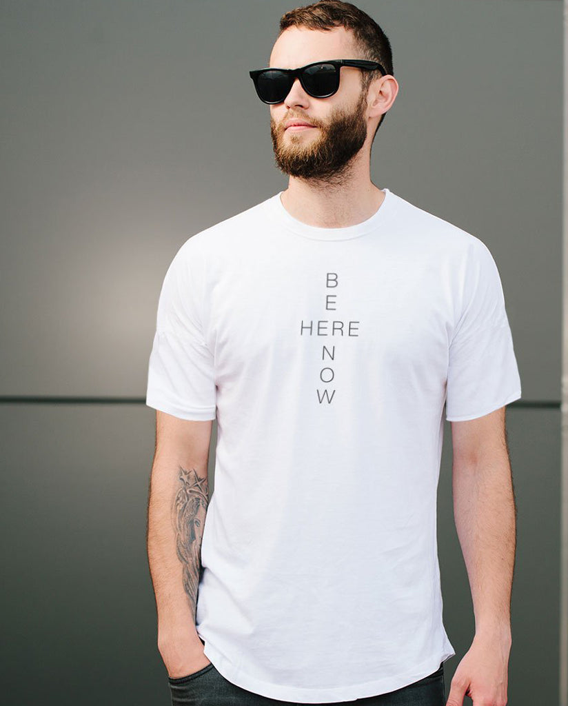 BE HERE NOW Unisex White Triblend Short Sleeve Tee by Tech Wellness